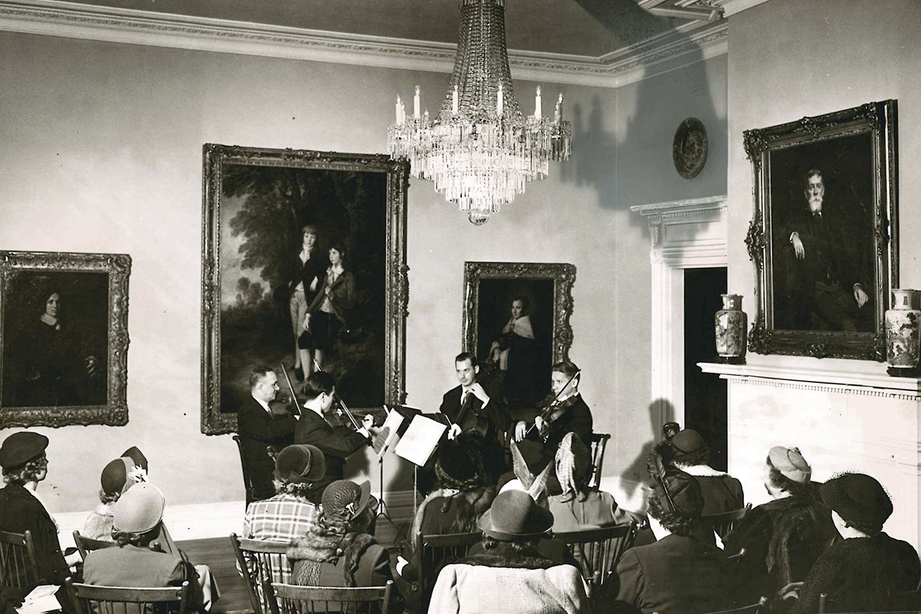 A string quartet performance in the Music Room at the Taft Museum of Art, 1952. Photograph from the Taft Museum of Art Archives, Cincinnati, Ohio